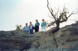 Jim, Mark, Bev, and Jeannette on big rock by our house