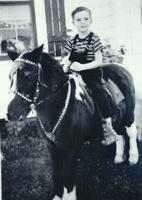 Richard, Jr. (Dick) on a horse